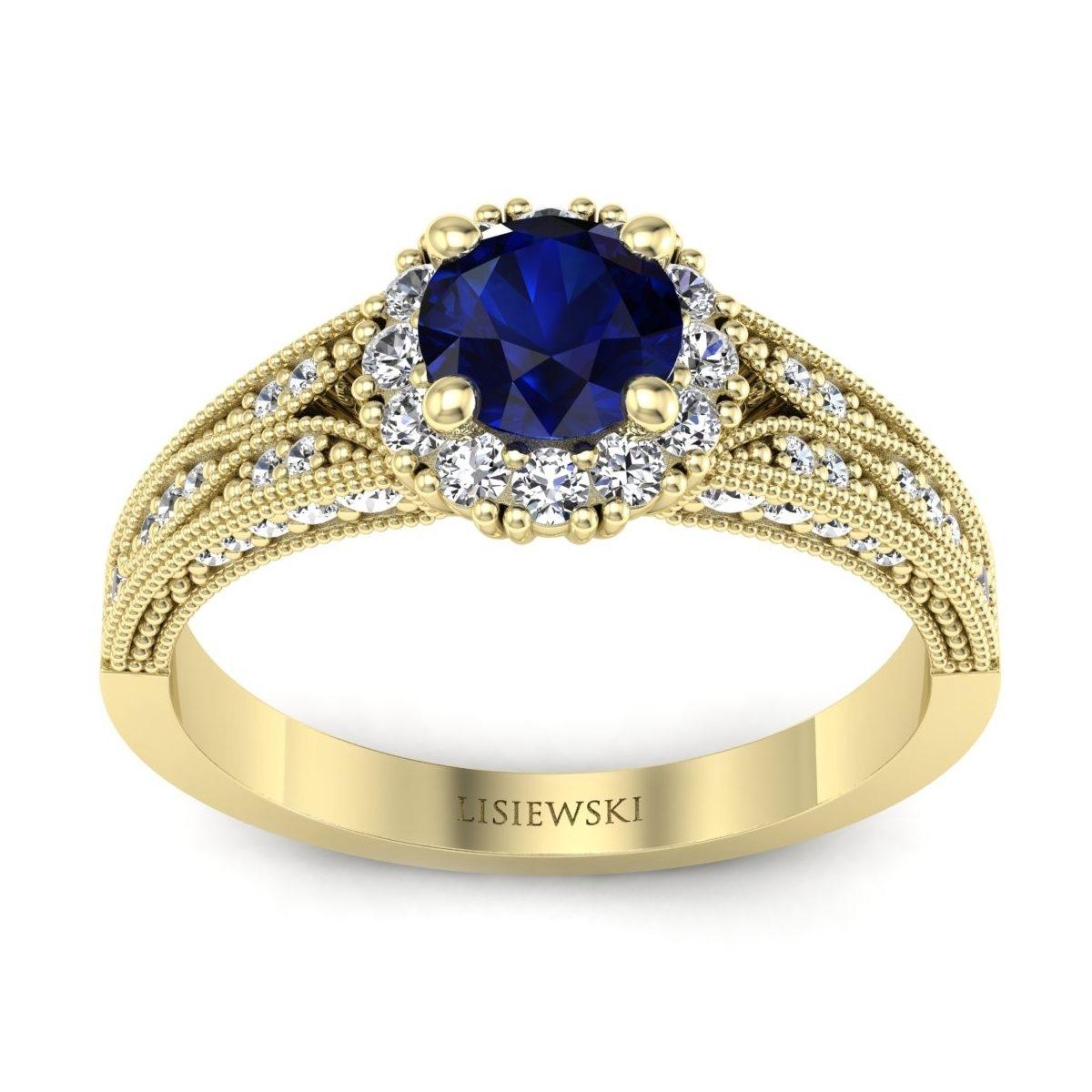 Eve - Złoty pierścionek z szafirem i diamentami