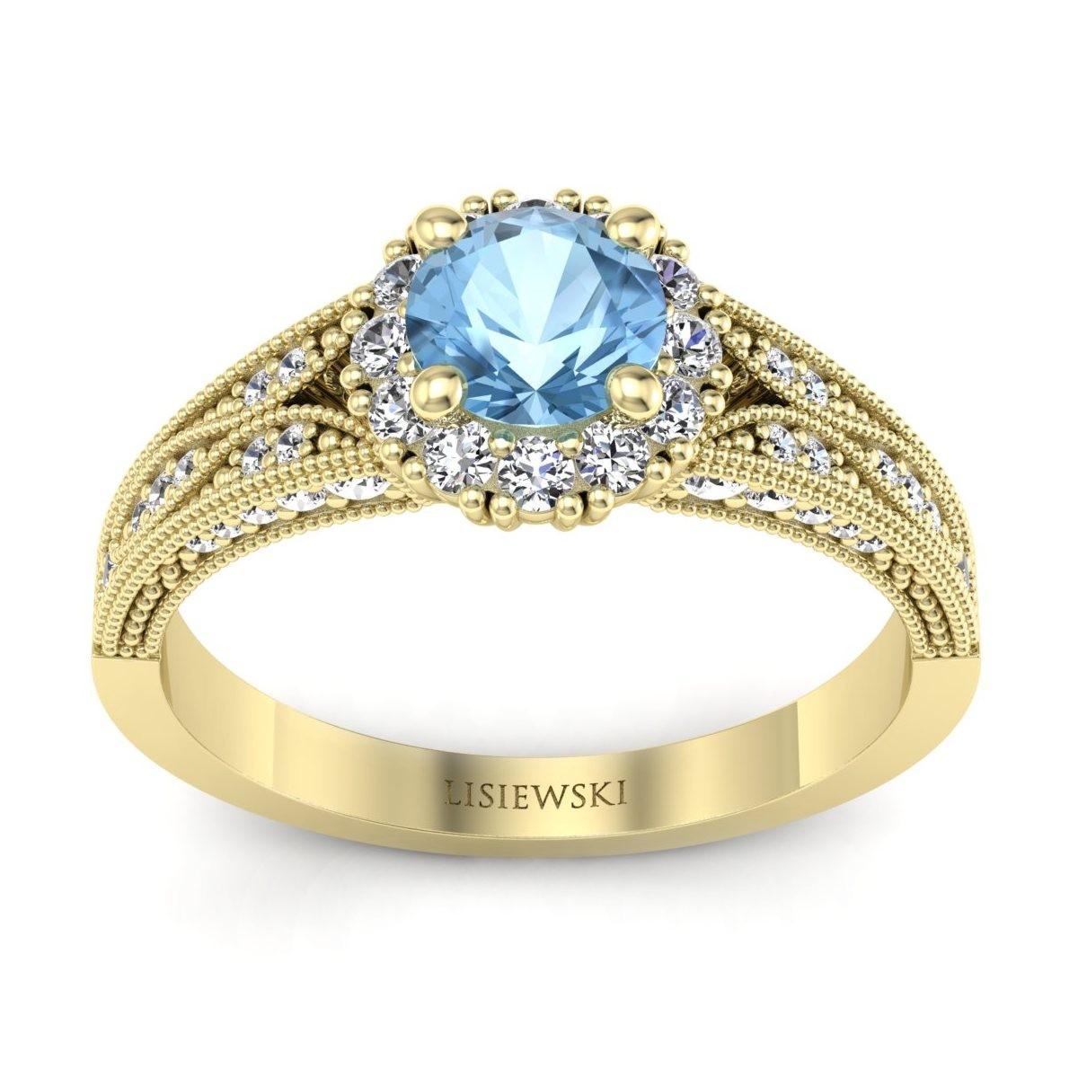 Eve - Złoty pierścionek z topazem i diamentami