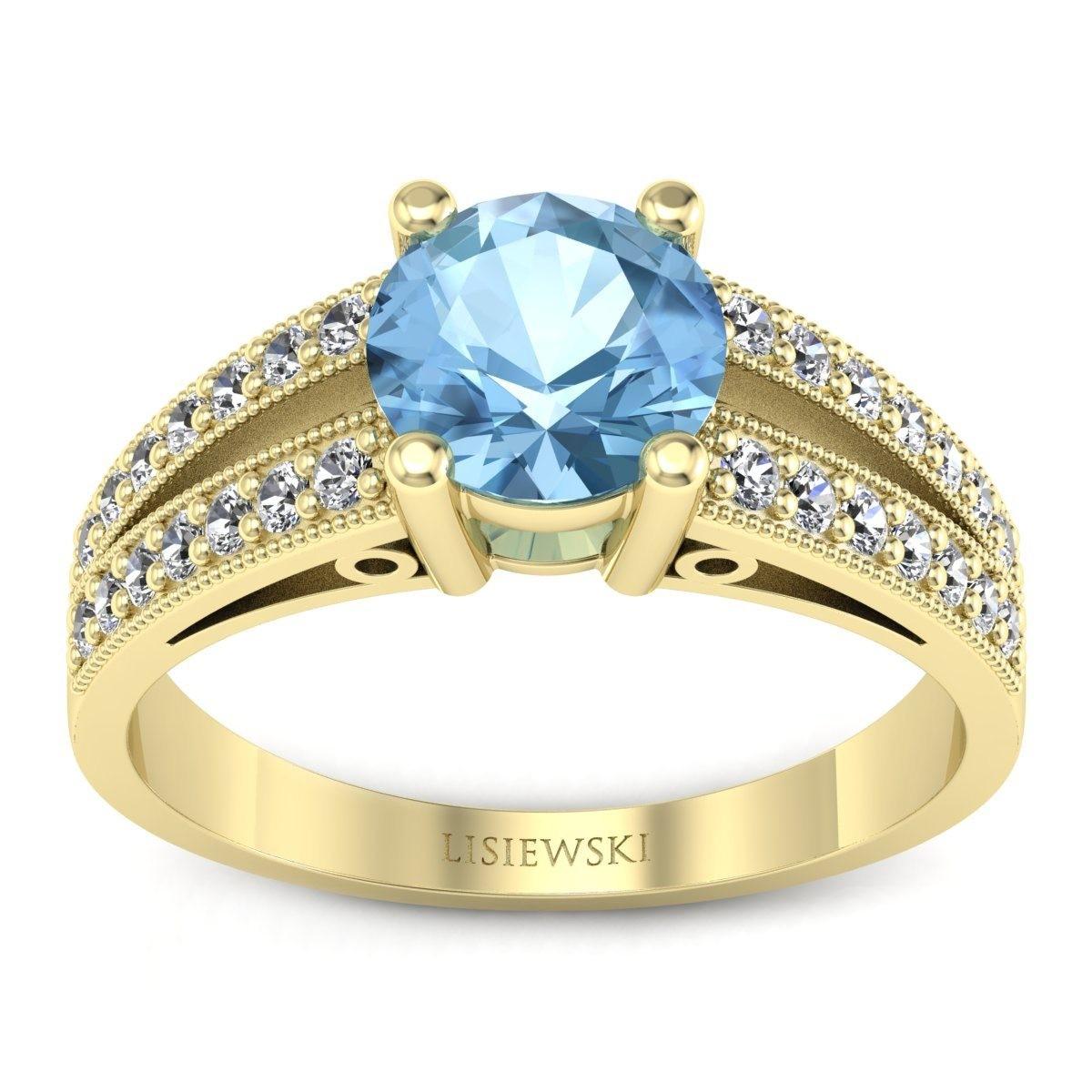 San Marino Złoty pierścionek z topazem i diamentami